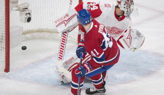 Montreal Canadiens' Paul Byron scores against Detroit Red Wings goaltender Petr Mrazek during the first period of an NHL hockey game, Saturday, Dec. 2, 2017 in Montreal. (Graham Hughes/The Canadian Press via AP)
