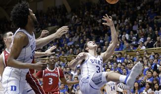 Duke's Grayson Allen (3) puts up a shot as Duke's Marvin Bagley III looks on at left during the first half of an NCAA college basketball game against South Dakota in Durham, N.C., Saturday, Dec. 2, 2017. South Dakota's Triston Simpson (3) watches at rear. (AP Photo/Gerry Broome)