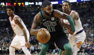 Boston Celtics' Kyrie Irving (11) looks to move against Phoenix Suns' Tyler Ulis right, during the third quarter of an NBA basketball game in Boston, Saturday, Dec. 2, 2017. The Celtics won 116-111. (AP Photo/Michael Dwyer)