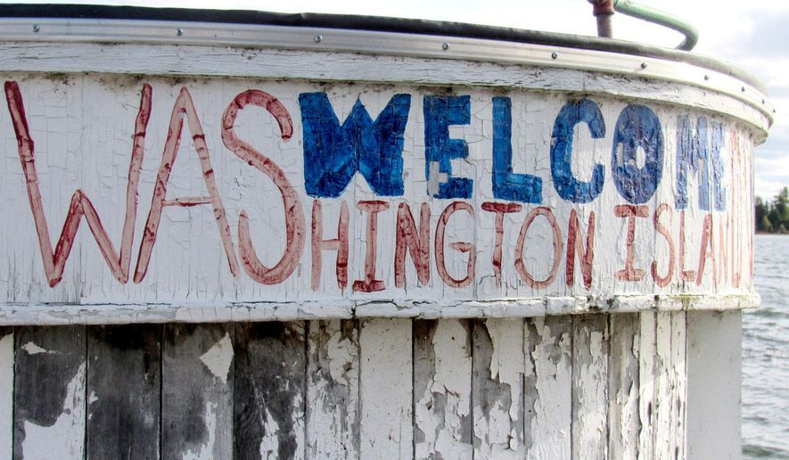Washington Island, Wis., a prime tourist destination in the summer and fall, is filled with history and celebrates its fishing, shipping and agricultural heritage. The island has about 650 year-round residents and also serves as the gateway to Rock Island State Park. A weathered marina sign for the island, pictured Friday, Oct. 6, 2017, welcomes visitors to the Door County destination. (Barry Adams/Wisconsin State Journal via AP)