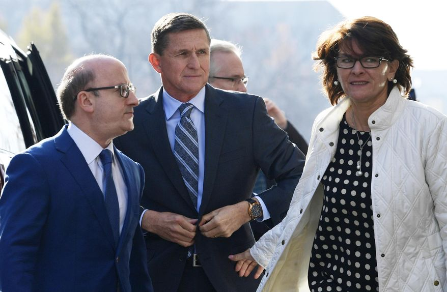 Former Trump national security adviser Michael Flynn, center, arrives at federal court in Washington, Friday, Dec. 1, 2017. (AP Photo/Susan Walsh)