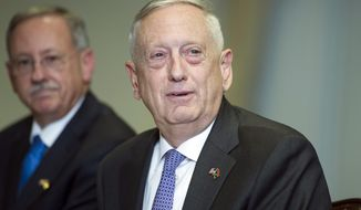 Defense Secretary Jim Mattis answers a reporter's question during a meeting with Libyan Prime Minister Fayez Serraj at the Pentagon, Thursday, Nov. 30, 2017. (AP Photo/Cliff Owen)
