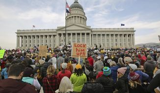 Supporters of the Bears Ears and Grand Staircase-Escalante National Monuments gather during a rally Saturday, Dec. 2, 2017, in Salt Lake City. President Donald Trump is expected to announce plans to shrink the two sprawling national monuments in Utah that were created by past Democratic presidents.  (AP Photo/Rick Bowmer)