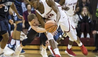 Saint Joseph's James Demery, right, gets fouled by Villanova's Donte DiVincenzo, left, as they go for the all during the first half of an NCAA college basketball game, Saturday, Dec. 2, 2017, in Philadelphia. (AP Photo/Chris Szagola)