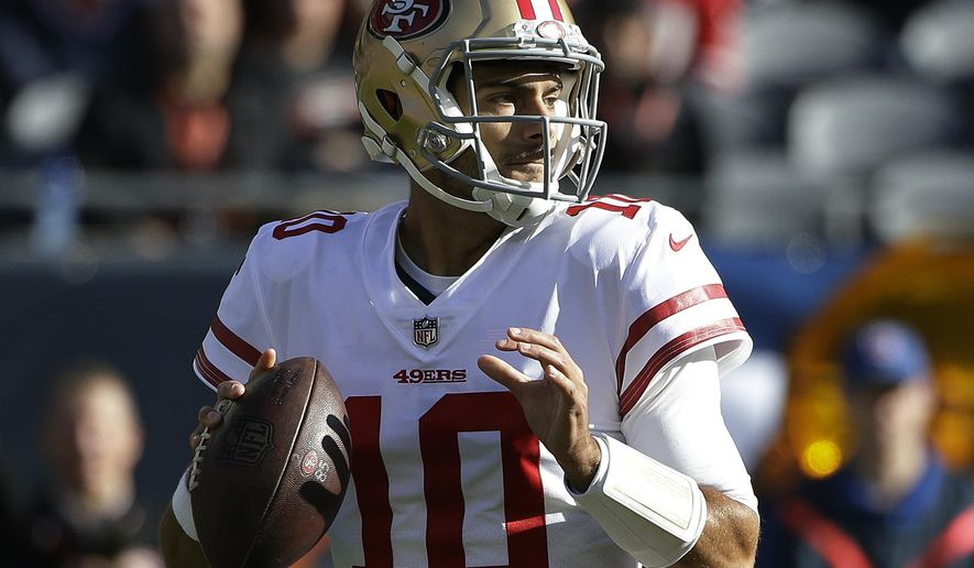 San Francisco 49ers quarterback Jimmy Garoppolo (10) looks for a receiver during the first half of an NFL football game against the Chicago Bears, Sunday, Dec. 3, 2017, in Chicago. (AP Photo/Nam Y. Huh)