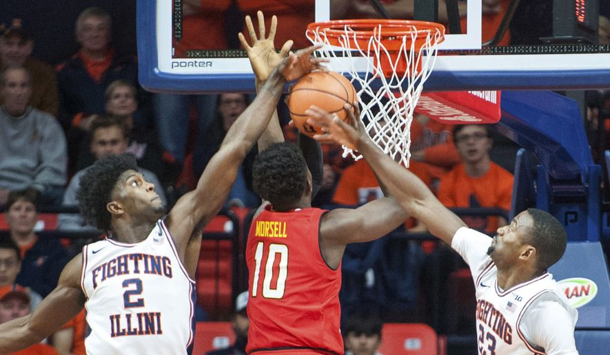 Illinois forward Kipper Nichols (2) and guard Aaron Jordan (23) attempt to block a shot by Maryland guard Darryl Morsell (10) during an NCAA college basketball game in Champaign, Ill., Sunday, Dec. 3, 2017. (AP Photo/Robin Scholz)