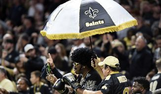 New Orleans Saints fans cheer in the second half of an NFL football game against the Carolina Panthers in New Orleans, Sunday, Dec. 3, 2017. (AP Photo/Bill Feig)