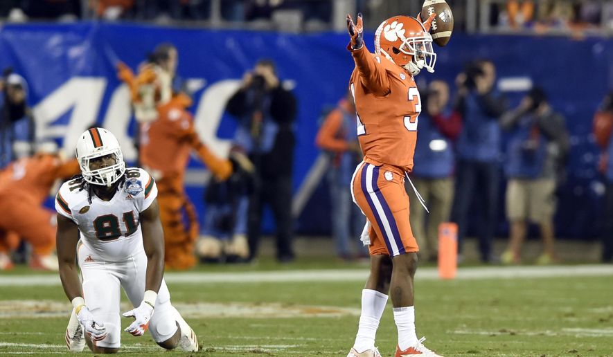 Clemson's Ryan Carter (31) celebrates his interceptions against Miami's Darrell Langham (81) during the second half of the Atlantic Coast Conference championship NCAA college football game in Charlotte, N.C., Saturday, Dec. 2, 2017. (AP Photo/Mike McCarn)
