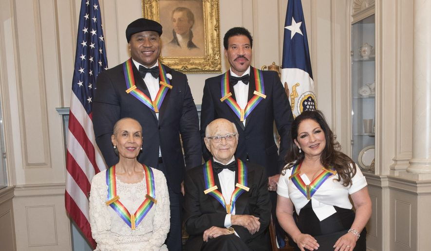 Front row from left, 2017 Kennedy Center Honorees Carmen de Lavallade, Norman Lear, Gloria Estefan, back row from left, LL Cool J, and Lionel Richie are photographed following the State Department dinner for the Kennedy Center Honors, Saturday, Dec. 2, 2017, in Washington. (AP Photo/Kevin Wolf)