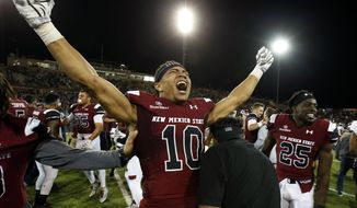 New Mexico State wide receiver Izaiah Lottie (10) celebrates the team's 22-17 victory over South Alabama in an NCAA college football game in Las Cruces, N.M., Saturday, Dec. 2, 2017. (AP Photo/Andres Leighton)