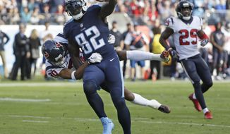 Tennessee Titans tight end Delanie Walker (82) drags Houston Texans cornerback Kevin Johnson (30) into the end zone as Walker scores a touchdown on a 24-yard pass in the second half of an NFL football game Sunday, Dec. 3, 2017, in Nashville, Tenn. (AP Photo/James Kenney)