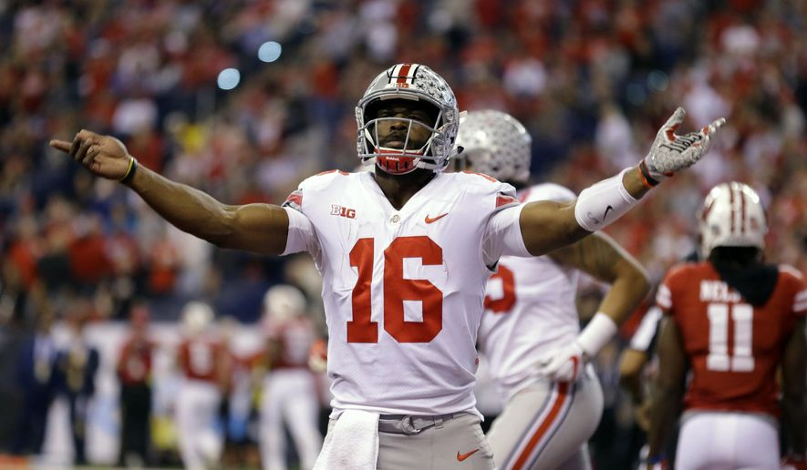 Ohio State quarterback J.T. Barrett celebrates after a 1-yard touchdown run during the first half of the Big Ten championship NCAA college football game against Wisconsin, Saturday, Dec. 2, 2017, in Indianapolis. (AP Photo/Michael Conroy)