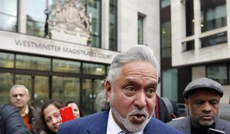FILE - In this Nov. 20, 2017 file photo, Indian tycoon Vijay Mallya leaves after attending a hearing at Westminster Magistrates Court in London. Mallya is due back in court in London on Monday, Dec. 4, 2017, for the start of an extradition hearing due to last about eight days that should determine whether he will be sent back to India to face money laundering allegations related to the collapse of several of his businesses. (AP Photo/Kirsty Wigglesworth, File)