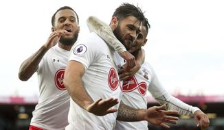 Southampton's Charlie Austin celebrates scoring his side's first goal of the game with teammates, during the English Premier League soccer match between Bournemouth and Southampton, at the Vitality Stadium, in Bournemouth, England, Sunday Dec. 3, 2017. (Adam Davy/PA via AP)