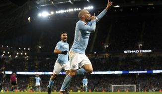 Manchester City's David Silva celebrates scoring his side's second goal of the game during the English Premier League soccer match between Manchester City and West Ham at the Etihad Stadium in, Manchester, England, Sunday Dec. 3, 2017. (Martin Rickett/PA via AP)