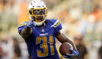 Los Angeles Chargers free safety Adrian Phillips celebrates his interception against the Cleveland Browns during the second half of an NFL football game Sunday, Dec. 3, 2017, in Carson, Calif. (AP Photo/Jae C. Hong)