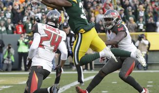 Green Bay Packers' Aaron Jones leaps in the end zone for a touchdown during overtime of an NFL football game against the Tampa Bay Buccaneers Sunday, Dec. 3, 2017, in Green Bay, Wis. The Packers won 26-20. (AP Photo/Morry Gash)