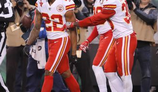 Teammates of Kansas City Chiefs' Marcus Peters, left, try to prevent him from leaving the field after a penalty during the second half of the team's NFL football game against the New York Jets, Sunday, Dec. 3, 2017, in East Rutherford, N.J. (AP Photo/Julie Jacobson)
