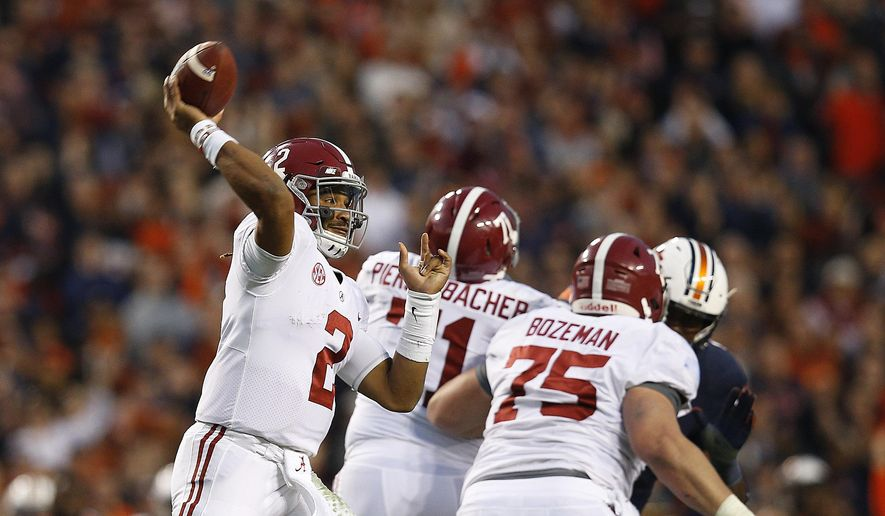 FILE - In this Nov. 25, 2017, file photo, Alabama quarterback Jalen Hurts throws the ball during the second half of the Iron Bowl NCAA college football game, in Auburn, Ala. The Associated Press voters prefer Alabama over Ohio State. In the final Top 25 of the regular season, the Crimson Tide was No. 4 and the Buckeyes were No. 5. (AP Photo/Brynn Anderson, File) **FILE**