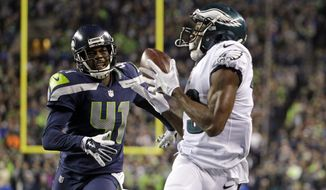 Philadelphia Eagles' Nelson Agholor grabs a pass for a touchdown as Seattle Seahawks' Byron Maxwell trails in the second half of an NFL football game, Sunday, Dec. 3, 2017, in Seattle. (AP Photo/Ted S. Warren)