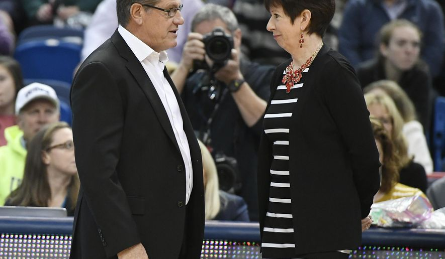 Connecticut head coach Geno Auriemma, left, talks with Notre Dame head coach Muffet McGraw before an NCAA college basketball game Sunday, Dec. 3, 2017, in Hartford, Conn. (AP Photo/Jessica Hill)