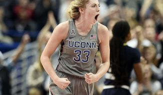 Connecticut's Katie Lou Samuelson reacts after making a basket during the first half an NCAA college basketball game against Notre Dame, Sunday, Dec. 3, 2017, in Hartford, Conn. (AP Photo/Jessica Hill)