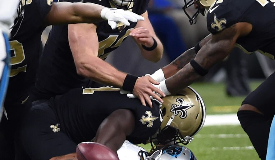 Carolina Panthers returner Kaelin Clay (12) fumbles a punt which the New Orleans Saints recovered in the second half of an NFL football game in New Orleans, Sunday, Dec. 3, 2017. (AP Photo/Bill Feig)