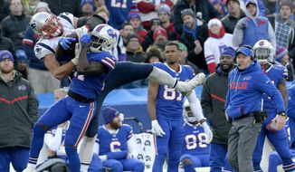 New England Patriots tight end Rob Gronkowski, left, makes a catch as Buffalo Bills cornerback Tre'Davious White (27) defends during the second half of an NFL football game, Sunday, Dec. 3, 2017, in Orchard Park, N.Y. Bills head coach Sean McDermott, right, looks on during the play. (AP Photo/Adrian Kraus) **FILE**