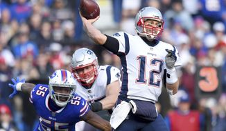 New England Patriots quarterback Tom Brady (12) throws a pass as Buffalo Bills defensive end Jerry Hughes (55) rushes by the block of offensive tackle Nate Solder (77) during the first half of an NFL football game, Sunday, Dec. 3, 2017, in Orchard Park, N.Y. (AP Photo/Rich Barnes)