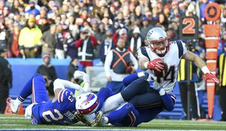 New England Patriots running back Rex Burkhead (34) dives in for a touchdown as Buffalo Bills strong safety Micah Hyde (23) and free safety Jordan Poyer (21) try to stop him during the second half of an NFL football game, Sunday, Dec. 3, 2017, in Orchard Park, N.Y. (AP Photo/Rich Barnes)
