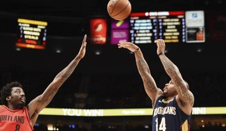New Orleans Pelicans guard Jameer Nelson shoots over Portland Trail Blazers forward Al-Farouq Aminu during the first half of an NBA basketball game in Portland, Ore., Saturday, Dec. 2, 2017. (AP Photo/Steve Dykes)