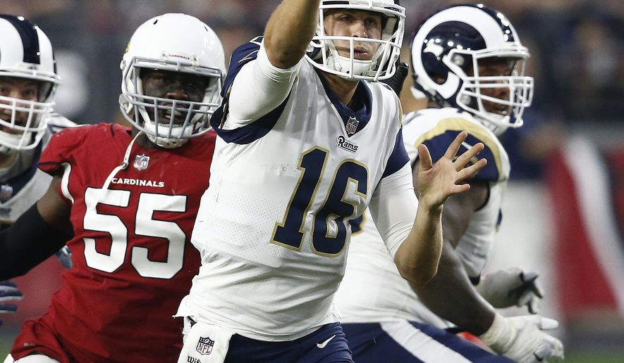 Los Angeles Rams quarterback Jared Goff (16) throws as Arizona Cardinals outside linebacker Chandler Jones (55) pursues during the second half of an NFL football game, Sunday, Dec. 3, 2017, in Glendale, Ariz. (AP Photo/Ross D. Franklin)