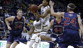 California's Don Coleman, center, drives past Saint Mary's Jock Landale (34) and Cullen Neal (44) during the first half of an NCAA college basketball game Saturday, Dec. 2, 2017, in Berkeley, Calif. (AP Photo/Ben Margot)