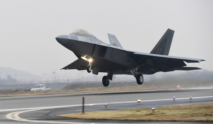 A U.S. Air Force F-22 Raptor takes off from a South Korean air base in Gwangju, South Korea, Monday, Dec. 4, 2017. The United States and South Korea have started their biggest-ever joint air force exercise with hundreds of aircrafts including two dozen stealth jets. (Yonhap via AP)