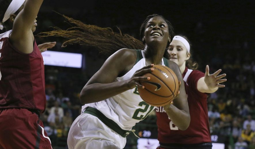Baylor center Kalani Brown looks to the basket as Stanford forward/center Shannon Coffee, right, defends during the second half of an NCAA college basketball game Sunday, Dec. 3, 2017, in Waco, Texas. (Rod Aydelotte/Waco Tribune Herald via AP)