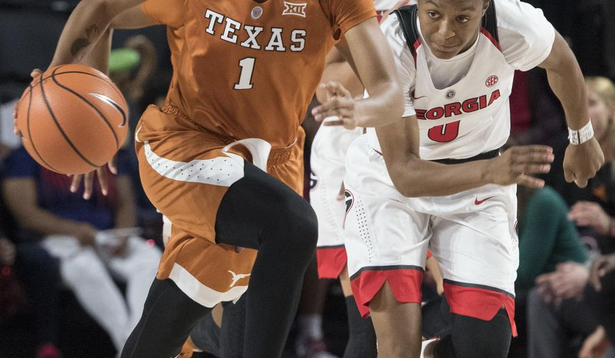 Texas guard Alecia Sutton (1) drives up the floor with Georgia guard Taja Cole in close pursuit after stealing the ball during the first half of an NCAA college basketball game, Sunday, Dec. 3, 2017, in Athens, Ga. (AP Photo/John Amis)