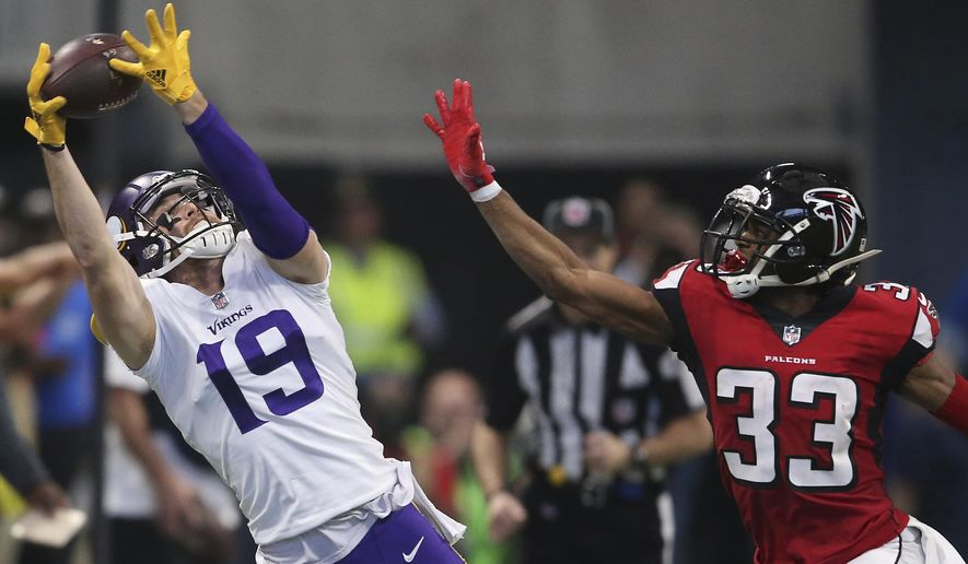 Minnesota Vikings wide receiver Adam Thielen (19) makes the catch but out of bounds against Atlanta Falcons defensive back Blidi Wreh-Wilson (33) during the first half of an NFL football game, Sunday, Dec. 3, 2017, in Atlanta. (AP Photo/John Bazemore)