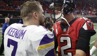 Atlanta Falcons quarterback Matt Ryan (2) speaks with Minnesota Vikings quarterback Case Keenum (7) after an NFL football game, Sunday, Dec. 3, 2017, in Atlanta. The Minnesota Vikings won 14-9. (AP Photo/David Goldman)