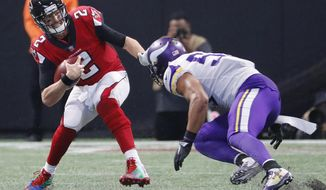 Atlanta Falcons quarterback Matt Ryan (2) runs into Minnesota Vikings outside linebacker Anthony Barr (55) during the second half of an NFL football game, Sunday, Dec. 3, 2017, in Atlanta. (AP Photo/David Goldman)