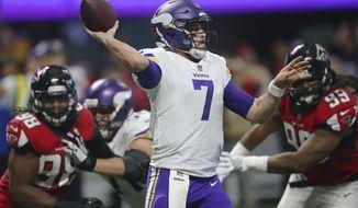 Minnesota Vikings quarterback Case Keenum (7) works under pressure from Atlanta Falcons defensive end Adrian Clayborn (99) during the second half of an NFL football game, Sunday, Dec. 3, 2017, in Atlanta. (AP Photo/John Bazemore)