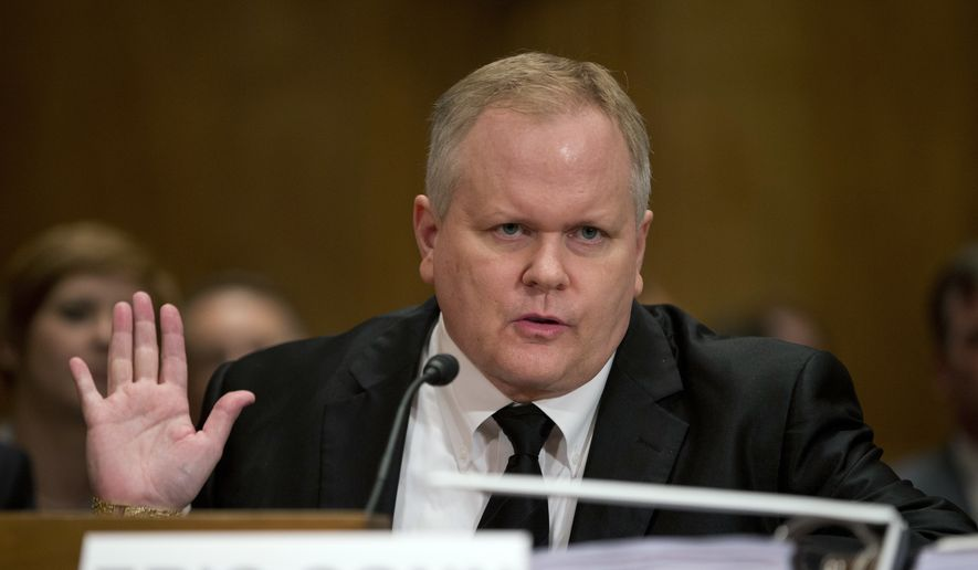 Eric Conn gestures as he invokes his Fifth Amendment rights against self-incrimination during a Senate Homeland Security and Governmental Affairs committee hearing on Capitol Hill in Washington. Conn had help in carrying out the escape plot he hatched a year before fleeing, according to a federal indictment. The indictment, released Monday, Oct. 16, 2017,  alleges that an employee of Conn, the missing lawyer, opened a bank account that Conn used to transfer money out of the country. It also claims that the employee, Curtis Lee Wyatt, tested security at the U.S-Mexico border at Conn's direction, and purchased a pickup truck for use in Conn's escape in early June. (AP Photo/ Evan Vucci, File)