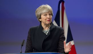 British Prime Minister Theresa May speaks during a media conference at EU headquarters in Brussels on Monday, Dec. 4, 2017. British Prime Minister Theresa May and EU Commission President Jean-Claude Juncker held a power lunch on Monday, seeking a breakthrough in the Brexit negotiations ahead of a key EU summit the week after. (AP Photo/Virginia Mayo)