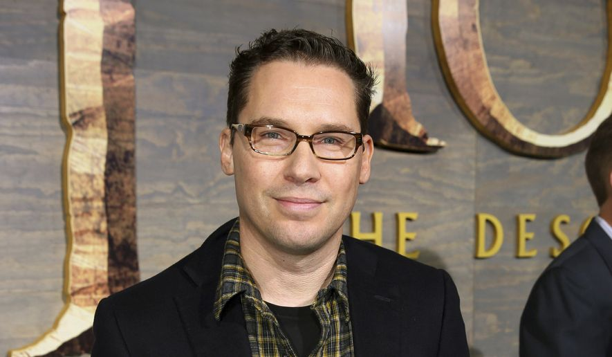 """This Dec. 2, 2013, file photo shows Bryan Singer at the Los Angeles premiere of """"The Hobbit: The Desolation of Smaug"""" at the Dolby Theatre. Singer has left the Queen biopic """"Bohemian Rhapsody"""" in the middle of production. A representative for Twentieth Century Fox Film Corp. said Monday, Dec. 4, 2017, that Singer is no longer the director of the film. (Photo by Matt Sayles/Invision/AP, File)"""