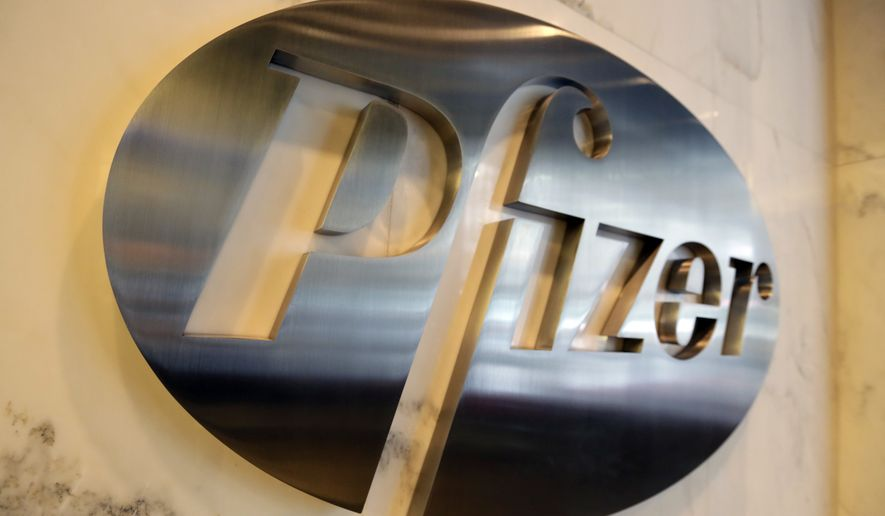The Pfizer company logo is photographed at Pfizer Inc. headquarters, in New York, Monday, Dec. 4, 2017. (AP Photo/Richard Drew)