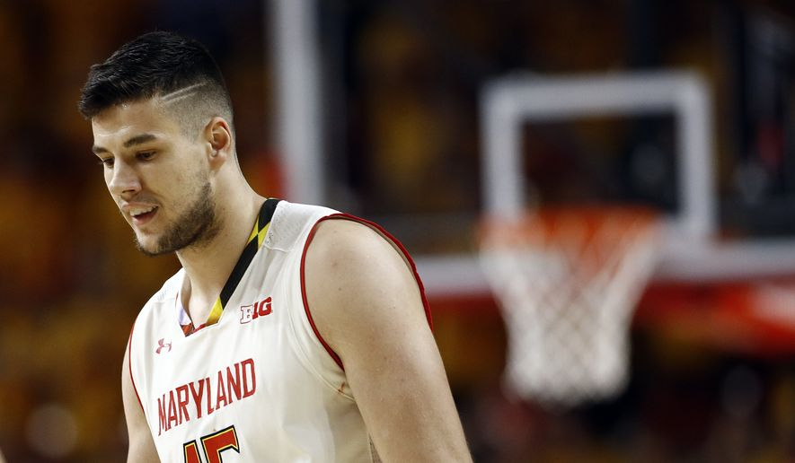 Maryland center Michal Cekovsky, of Slovakia, walks on the court in the first half of an NCAA college basketball game against Purdue in College Park, Md., Friday, Dec. 1, 2017. (AP Photo/Patrick Semansky) **FILE**