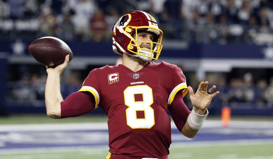 Washington Redskins quarterback Kirk Cousins (8) throws a pass during warmups before an NFL football game against the Dallas Cowboys on Thursday, Nov. 30, 2017, in Arlington, Texas. (AP Photo/Michael Ainsworth)