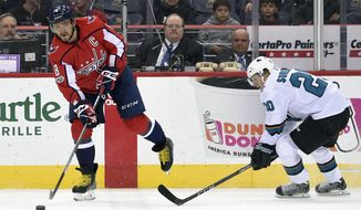 Washington Capitals left wing Alex Ovechkin (8), of Russia, skates with the puck against San Jose Sharks left wing Marcus Sorensen (20) during the first period of an NHL hockey game, Monday, Dec. 4, 2017, in Washington. (AP Photo/Nick Wass)