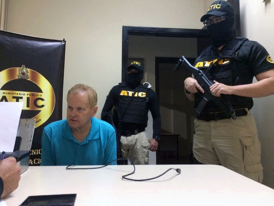 This photo provided by the Honduras public magistrate's office shows Eric Conn with Technical Agency of Criminal Investigation (ATIC) agents after he was captured by police on Monday, Dec. 4, 2017, in the city of La Ceiba, Atlantida, Honduras. Conn, a fugitive Kentucky lawyer who escaped before facing sentencing for his central role in a massive Social Security fraud case, is expected to be transferred to the U.S. on Tuesday. (Honduras public magistrate's office via AP)