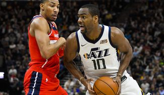 Washington Wizards forward Otto Porter Jr., left, attempts to guard againstUtah Jazz guard Alec Burks, right, in the second half of an NBA basketball game Monday, Dec. 4, 2017, in Salt Lake City. (AP Photo/Alex Goodlett)