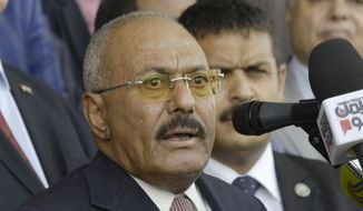 "In this Aug. 24, 2017, file photo, former Yemeni President Ali Abdullah Saleh speaks during a ceremony to celebrate the 35th anniversary of the founding of the Popular Conference Party, in Sanaa, Yemen. Yemenis in the war-torn country's capital crowded into basements overnight, Monday Dec. 4, 2017, as Saudi-led fighter jets pounded the positions of Houthi rebels, who are now fighting forces loyal to Saleh for control of the city. A Sanaa-based protection and advocacy adviser for the Norwegian Refugee Council said Monday that the violence left aid workers trapped inside their homes and was ""completely paralyzing humanitarian operations."" (AP Photo/Hani Mohammed, File)"